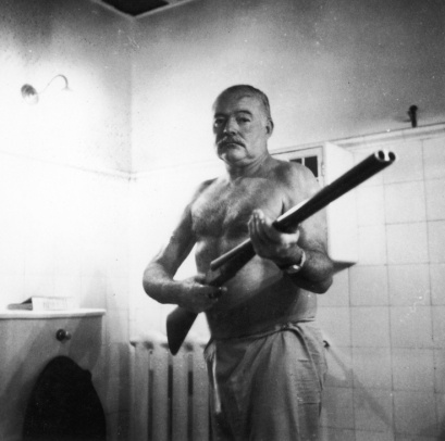 Ernest Hemingway in shorts ... with a rifle