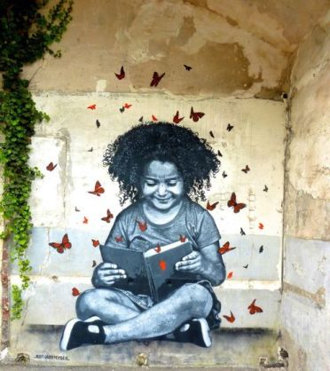 Reading on the street, graffiti Jef Aerosol